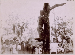 CLICK TO ENLARGE: Large crowd looking at the burned body of Jesse Washington, 18 year-old African-American, lynched in Waco, Texas, May 15, 1916. (Library of Congress)